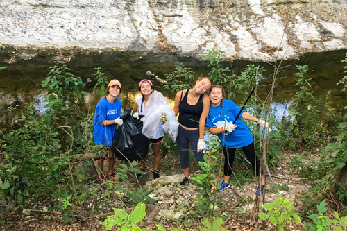 students participating in annual EHS waller creek cleanup